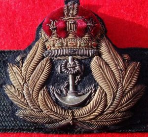 WW2 ROYAL NAVY CAP BADGE ON CAP BAND