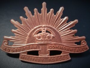 AUSTRALIAN ANZAC WW1 & WW2 RISING SUN UNIFORM HAT BADGE