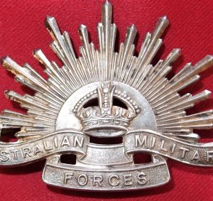 WHITE METAL AUSTRALIAN ANZAC POST WW2 RISING SUN UNIFORM HAT OR CAP BADGE MEDAL