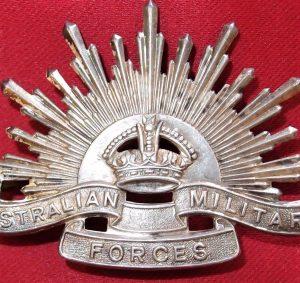 WHITE METAL AUSTRALIAN ANZAC POST WW2 RISING SUN UNIFORM HAT OR CAP BADGE MEDAL