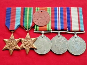 WW2 ROYAL AUSTRALIAN NAVY GROUP OF 5 MEDALS TO 20258 W.H.GLEN. WITH DOG TAG