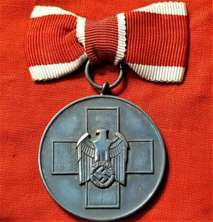 WW2 GERMAN RED CROSS SOCIAL WELFARE MEDAL WITH FEMALE TIED BOW RIBBON
