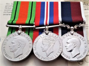 WW2 R.A.F Long Service Medal group of 3 to Pilot Officer C.T.D Nicholls, who was commissioned from the ranks